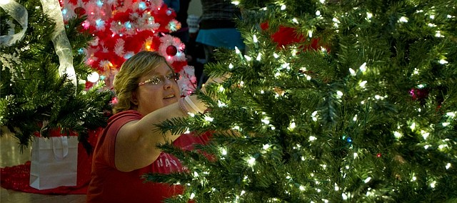 The holiday season truly kicks off with the Lawrence Festival of Trees at Liberty Hall. Nearly 60 trees and 25 wreaths decorated and donated by local individuals and groups are on display, and will be sold during the Auction Party on Tuesday. The Lawrence Festival of Trees is from 10 a.m. to 8:30 p.m. at Liberty Hall, 644 Massachusetts St.