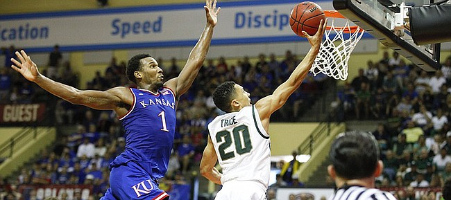 Kansas guard Wayne Selden Jr. (1) gets airborne before pinning a layup by Michigan State guard Travis Trice (20) against the backboard for a block during the second half on Sunday, Nov. 30, 2014 at the HP Field House in Kissimmee, Florida.