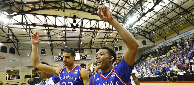 Kansas guard Devonte Graham (4) and forward Landen Lucas (33) salute the Jayhawk fans following their victory over Michigan State on Sunday, Nov. 30, 2014 at the HP Field House in Kissimmee, Florida.