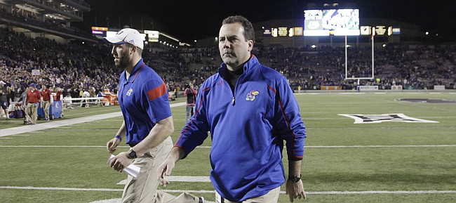 KU athletic director Sheahon Zenger leaves the field after the Jayhawks 51-13 loss to the Kansas State Wildcats Nov. 29. 2014.