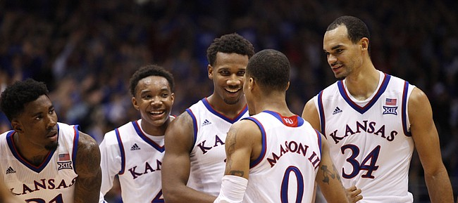 Kansas players Jamari Traylor, left, Devonte Graham, Wayne Selden and Perry Ellis surround Frank Mason before a pair of free throws by Mason during the second half on Friday, Dec. 5, 2014 at Allen Fieldhouse.