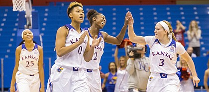 Kansas players were all smiles as they head towards the bench after defeating No. 10 Cal, 62-39, Sunday at Allen Fieldhouse.