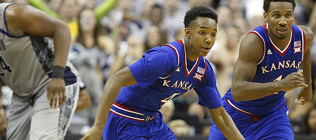 Kansas guards Devonte Graham (4) and Wayne Selden Jr. (1) run up the court after coming away with a steal from Georgetown center Joshua Smith (24) during the second half on Wednesday, Dec. 10, 2014 at Verizon Center in Washington D.C.