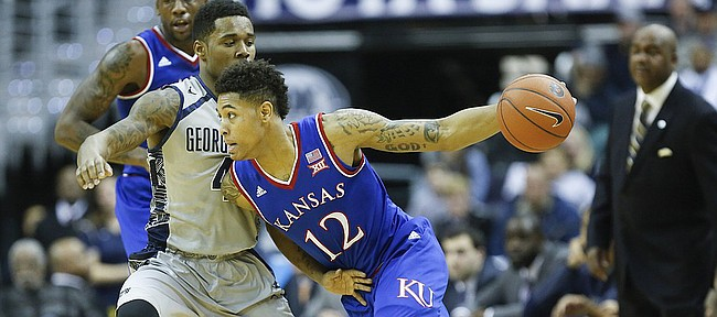 Kansas guard Kelly Oubre Jr. (12) drives against Georgetown guard D'Vauntes Smith-Rivera (4) during the first half on Wednesday, Dec. 10, 2014 at Verizon Center in Washington D.C.