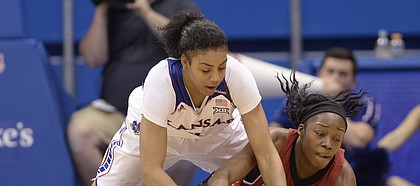Forward Jada Brown dives to the ground with Amanda Lawson of Arkansas State to try and gain possession of a loose ball in the second half Sunday at Allen Fieldhouse.