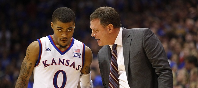Kansas head coach Bill Self has a chit-chat with point guard Frank Mason during the second half on Friday, Dec. 5, 2014 at Allen Fieldhouse.