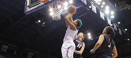 Kansas University senior guard Asia Boyd (0) gets up for two of her 13 points in the Jayhawks' 66-44 victory over Samford on Monday, Dec. 29, 2014, in Allen Fieldhouse.