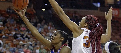 Kansas forward Chelsea Gardner, center, shoots against Texas center Imani McGee-Stafford, second from right, during the first half an NCAA college basketball game, Saturday, Jan. 3, 2015, in Austin, Texas. (AP Photo/Michael Thomas)