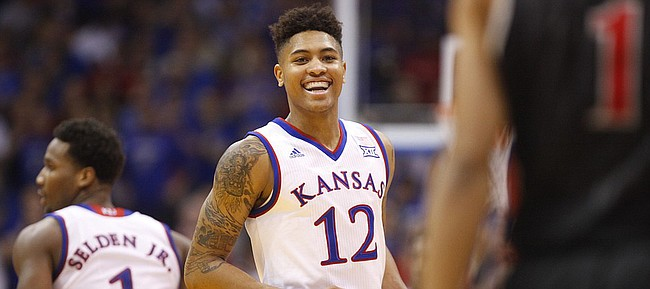 Kansas guard Kelly Oubre Jr. (12) smiles at UNLV guard Rashad Vaughn (1) after a bucket during the first half on Sunday, Jan. 4, 2015 at Allen Fieldhouse.