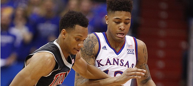 Kansas guard Kelly Oubre Jr. (12) knocks the ball away from UNLV guard Rashad Vaughn (1) for a steal during the second half on Sunday, Jan. 4, 2015 at Allen Fieldhouse.