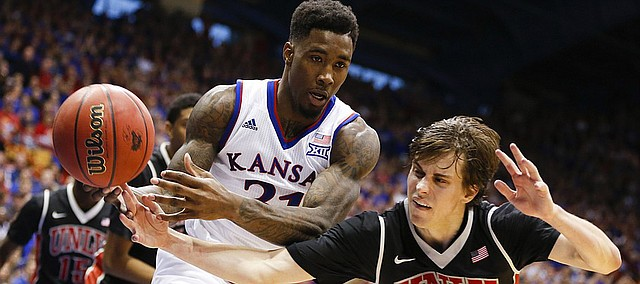 Kansas forward Jamari Traylor (31) fights for control of a rebound with UNLV guard Cody Doolin (45) during the second half on Sunday, Jan. 4, 2015 at Allen Fieldhouse.