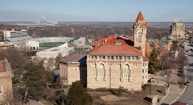 "As World War I marks its 100th anniversary, KU is home to two massive memorials to the war: Memorial Stadium, pictured at upper left in distance, and the Memorial Union, seen behind Dyche Hall at right of center. A former KU chancellor decreed decades ago that future war memorials should be ""pure"" memorials, not excuses ""to fill a need at the University."""