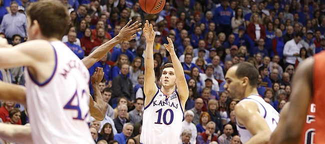 Kansas guard Sviatoslav Mykhailiuk (10) puts up a three pointer during the first half on Saturday, Jan.10, 2015 at Allen Fieldhouse.
