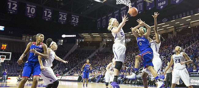 Kansas senior guard Asia Boyd (0) loses the ball under the basket while being double teamed by Kansas State's Shaelyn Martin (50) and Breanna Lewis (22)  during the second half of their game Sunday afternoon at Bramlage Coliseum in Manhattan. Despite a quick start by the Jayhawks that saw them surge to a 14 point lead, Kansas fell to the Wildcats, 58-52, and dropped to 0-3 in Big 12 play.