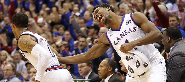 Kansas guard Wayne Selden Jr. (1) celebrates a three pointer by Kansas guard Frank Mason III (0) during the second half, Tuesday, Jan. 13, 2015 at Allen Fieldhouse.