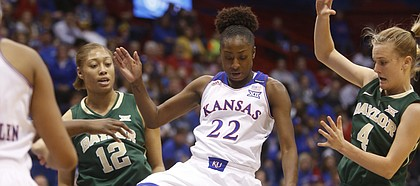 Kansas freshman Chayla Cheadle (22) loses the ball against Baylor's defense in the Jayhawks' 71-63 loss to Baylor on Saturday, Jan. 17, 2015, in Allen Fieldhouse.