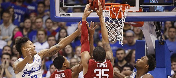 Kansas guard Kelly Oubre Jr. (12), forward Perry Ellis, and Kansas guard Wayne Selden Jr., right, battle for a rebound with Oklahoma guard Isaiah Cousins (11) and Oklahoma TaShawn Thomas (35) during the first half on Monday, Jan. 19, 2015 at Allen Fieldhouse.
