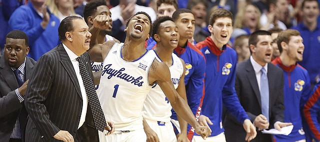 Kansas guard Wayne Selden Jr. (1) and the rest of the bench celebrate a three by teammate Brannen Greene to reclaim the lead late in the second half on Monday, Jan. 19, 2015 at Allen Fieldhouse.