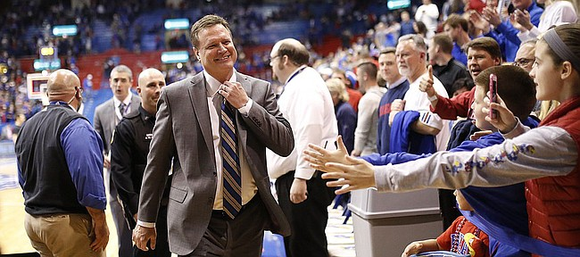 Kansas head coach Bill Self loosens his tie with a smile as he leaves the court following the Jayhawks' 85-78 win over Oklahoma on Monday, Jan. 19, 2015 at Allen Fieldhouse.