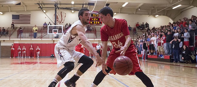 Eudora sophomore Mitchell Ballock knocks the ball away from Tonganoxie senior Brady Swedo (24) during the first round of the Tonganoxie Invitational Tuesday in Tonganoxie.