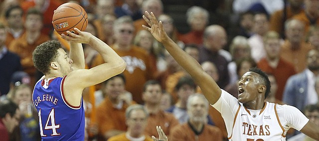 Kansas guard Brannen Greene (14) pulls up for a three as he is defended by Texas forward Myles Turner (52) during the second half, Saturday, Jan. 24, 2015 at Frank Erwin Center in Austin, Texas.