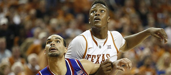 Kansas forward Perry Ellis (34) boxes out Texas forward Myles Turner during the second half, Saturday, Jan. 24, 2015 at Frank Erwin Center in Austin, Texas.