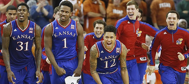 Kansas players Jamari Traylor, left, Wayne Selden, Kelly Oubre, Tyler Self and Evan Manning go wild during a timeout in the second half on Saturday, Jan. 24, 2015 at Frank Erwin Center in Austin, Texas.