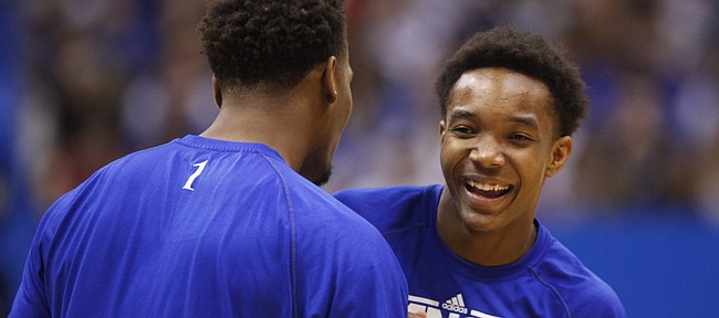 Kansas players Devonte Graham, right, and Wayne Selden clown around during warmups prior to tipoff against Oklahoma on Monday, Jan. 19, 2015 at Allen Fieldhouse.