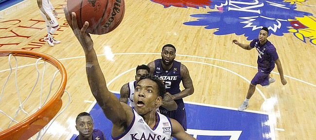 Kansas guard Devonte Graham (4) gets in for a bucket against Kansas State during the second half on Saturday, Jan. 31, 2015 at Allen Fieldhouse.