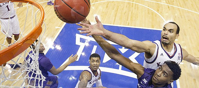 Kansas forward Perry Ellis fights for a rebound with Kansas State forward Nino Williams (11) during the second half on Saturday, Jan. 31, 2015 at Allen Fieldhouse.