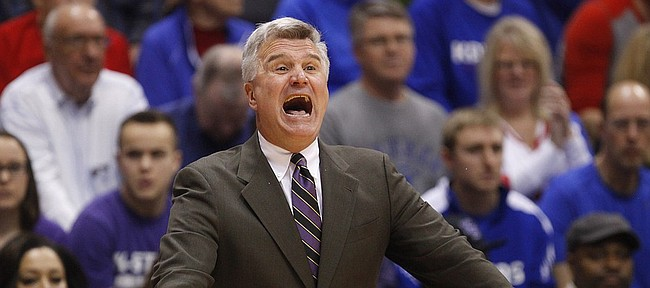 Kansas State head coach Bruce Weber looks to grab his players attention during the first half on Saturday, Jan. 31, 2015 at Allen Fieldhouse.