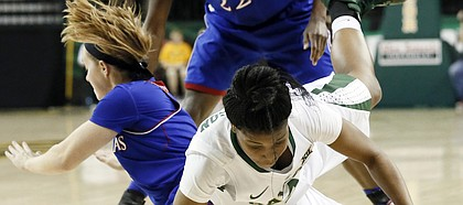 Baylor guard Niya Johnson (2) falls to the ground chasing a loose ball that was stripped away by Kansas' Lauren Aldridge, left, and Chayla Cheadle (22) in the second half of an NCAA college basketball game, Sunday, Feb. 1, 2015, in Waco, Texas. Baylor won 66-58.