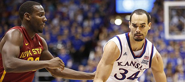 Kansas forward Perry Ellis (34) drives against Iowa State forward Dustin Hogue (22) during the second half on Monday, Feb. 2, 2015 at Allen Fieldhouse.