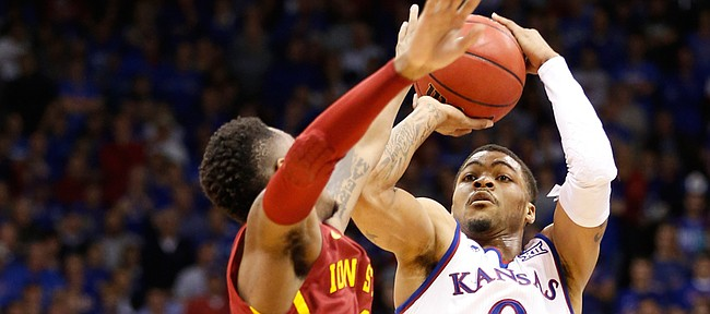 Kansas guard Frank Mason III (0) pulls up for a three before Iowa State guard Monte Morris (11) during the second half on Monday, Feb. 2, 2015 at Allen Fieldhouse.