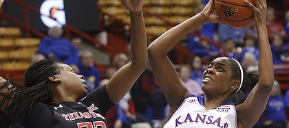 KU forward Chelsea Gardner (15) pulls up for a shot against Texas Tech's Dayo Olabode (32) on Wednesday, Feb. 4, 2015, in Allen Fieldhouse.