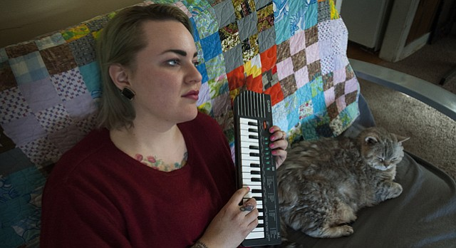 Musician Katlyn Conroy of the band La Guerre is pictured with one of her cats, Weatherby. For $20, Conroy will write a Valentine's Day love song for anyone who wants one.