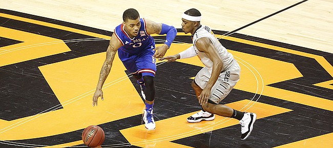 Kansas guard Frank Mason III (0) brings the ball across half court as he is defended by Oklahoma State guard Anthony Hickey Jr. (12) during the first half on Saturday, Feb. 7, 2015 at Gallagher-Iba Arena.