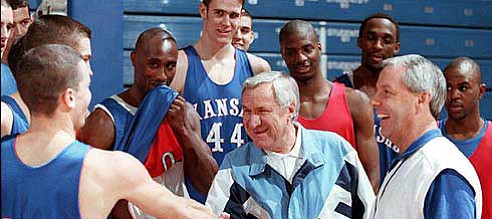 Former North Carolina coach Dean Smith, center, meets members of Kansas University's 1997-98 men's basketball team. Smith, who played at Kansas for coach Phog Allen, has recently become a vocal opponent of the death penalty.