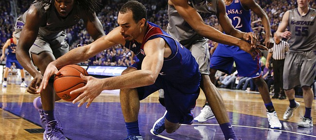 Kansas forward Perry Ellis tries to come away with a loose ball from Kansas State players D.J. Johnson, left, and Wesley Iwundu during the second half on Monday, Feb. 10, 2014 at Bramlage Coliseum.