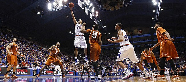 Kansas forward Perry Ellis (34) swoops in for a bucket late in the second half against Texas on Saturday, Feb. 28, 2015 at Allen Fieldhouse.