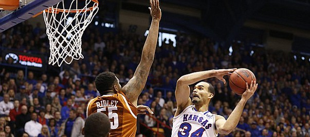 Kansas forward Perry Ellis (34) heads to the bucket against Texas center Cameron Ridley (55) during the first half on Saturday, Feb. 28, 2015 at Allen Fieldhouse.