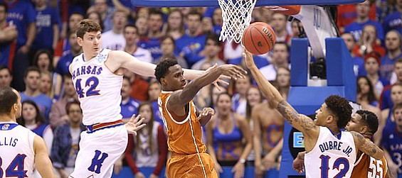 Texas guard Kendal Yancy (0) tosses a pass around the Kansas defense during the first half on Saturday, Feb. 28, 2015 at Allen Fieldhouse.