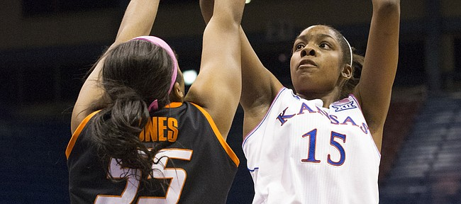 Kansas senior forward Chelsea Gardner (15) shoots over Oklahoma State defender Lashawn Jones (55) during the annual Jayhawks for a Cure game Saturday evening at Allen Fieldhouse.