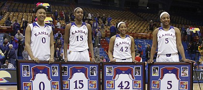 KU seniors, from left, Asia Boyd, Chelsea Gardner, Natalie Knight and Bunny Williams are honored as part of Senior Night on Monday, March 2, 2015, at Allen Fieldhouse.