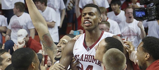 Oklahoma guard Buddy Hield (24) and the Oklahoma Sooner celebrate after he scored late in the Jayhawks' 75-73 loss to the Oklahoma Sooners Saturday, March 7, 2105 in Norman.
