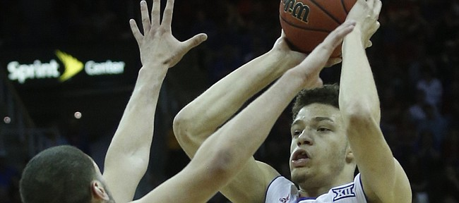 Kansas guard Brannen Greene (14) gets stopped by Iowa State's Matt Thomas (21) on Saturday March 14, 2015.