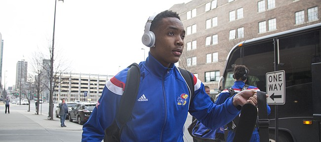 Kansas guard Devonte Graham picks up his luggage after the Jayhawks arrive in Omaha, Nebraska on Wednesday.