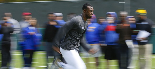 Former Kansas cornerback JaCorey Shepherd sprints to the finish of a timed 40 yard dash during Pro Day on Wednesday, March 25, 2015.