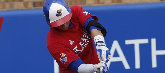 Kansas University freshman infielder Matt McLaughlin (5) singles as KU hosted New Mexico on Wednesday April 8, 2015 at Hoglund Ballpark.
