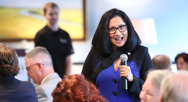 Neeli Bendapudi, dean of the Kansas University school of business, talks to the 2015 class of Academic All-Stars and their parents during a lunch on Tuesday, April 7, 2015 at Maceli's. Bendapudi had several bits of advice for the students including a request that they eventually bring their talents back to KU.